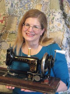 Pami Woodruff holding antique sewing machine