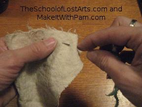 Demonstrating running stitch.