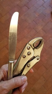 Vice grip pliers and a butter knife